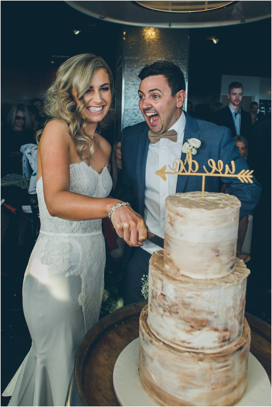 Melbourne Wedding Documentary photographer Coastal beach All Smiles cutting the cake